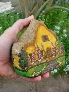 Painted Rock House - love the wee hollyhocks