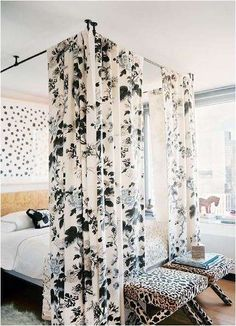 You don't need to buy a canopy bed to accomplish the look. All you need are curtains and some curtain rods. Set them up in the same box form around your bed. Voila! instant canopy bed!