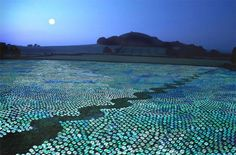 1 million unwanted CDs forming a sea landscape by Bruce Monroe