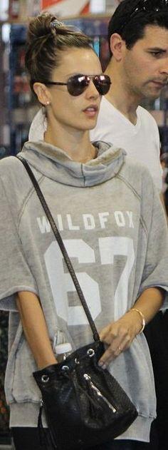 Who made  Alessandra Ambrosio's gray sweatshirt, aviator sunglasses, and black bucket handbag?