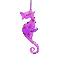 """Add a pop of color to your decor with this glass seahorse ornament. Featuring vivid and bright tones of magenta and purple, this glass ornament is bound to catch the eye. Perfect as a gift, memento, or Christmas tree ornament.  Dimensions: 5.5"""" tall  Item: #10864 $9.95"""