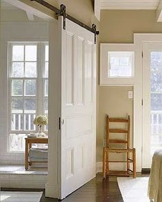 Sliding Barn Door This door isn't just a door--it also functions as a wall. The white doors are hung on barn door rollers and are easy to slide open and closed. Could be used between the living room and kitchen diner. Home Renovation, Barn Door Rollers, Interior Sliding Barn Doors, Sliding Doors, Entry Doors, Patio Doors, Entryway, Wood Doors, Barn Door Designs