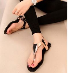 Image from http://i01.i.aliimg.com/wsphoto/v0/939987719/2013-new-shoes-for-women-beautiful-bohemia-blingbling-rhinestone-beaded-t-belt-pinch-flat-sandals-summer.jpg.