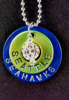 """Custom Seatle Seahawks Necklace!!  Double Washer Custom Stamped Necklace  Smaller Top Washer Bright Green - Stamped Seattle  Larger Bottom Washer Cobalt Blue - Stamped Seahawks  I hung a Silver Crystal Rhinestone as a charm to complete the look of this Necklace   18"""" Silver Ball Chain but can be ..."""