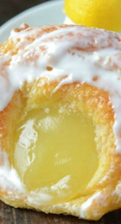 Lemon Danish | Delicate, flaky puff pastries topped with lemon curd and sweet sugar glaze.