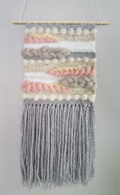 Handwoven wall hanging designed and made with love in Ontario, Canada. Beautiful multi-coloured weaving features high quality wool roving as well as a variety of yarns. This listing is for a *made to order* weaving in the colours and style shown (Grey, Pink, Cream, White). Images are an example of a previous design, actual piece will vary slightly. Approximately 10-11 wide x 22-24 long and comes hung on a wooden dowel. If you are looking for a specific colour scheme or size please contact...