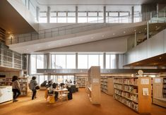 On the first floor, a children's library with a cheerful orange carpet sits within a double-height space. Floor Slab, Architectural Engineering, Orange Carpet, Interior And Exterior, Interior Design, Steel Panels, Minimal Home, Zaha Hadid Architects, Amazing Architecture