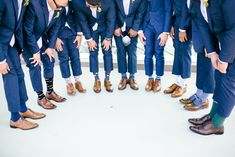 Groomsmen photo with fun socks at this Los Angeles rooftop wedding. Photo by Jenna Bechtholt Photography (via Ruffled).