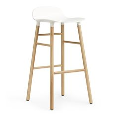 Normann+Copenhagen+Form+Barstool+75cm+-+Oak+-+Contemporary+plastic+shell+barstool+with+oak+legs.  Inject+a+touch+of+minimalist+charm+into+your+kitchen+interior+with+the+Normann+Copenhagen+Form+Barstool+-+Oak.  Designed+by+Simon+Legald,+Form+is+intended+as+a+rebirth+of+the+contemporary+shell+barstool,+reinterpreted+to+achieve+a+more+unified+look.  To+achieve+this+seamless,+integrated+aesthetic,+Normann+Copenhagen+have+developed+new+technology+to+join+the+seat+and+legs+together…