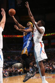 Ian Clark of the Golden State Warriors goes up for a lay up against the Oklahoma City Thunder on March 20 2017 at Chesapeake Energy Arena in Oklahoma...