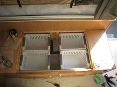 put boxes or bins under bench seat to keep things organized