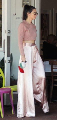 Kendall Jenner in an all-pink palette–Jonathan Simkhai top, Solace London pants, Louis Vuitton pouch, and Fendi charm