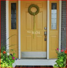 Love this painted front door, finished off with the house numbers http://kimkelly.uppercaseliving.net