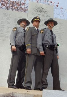 Capt. Maynard Gray, center, of the Pennsylvania State Police is proudly joined by his trooper sons, Matthew, left, and Michael, right.