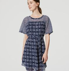 """In a modern mix of prints, a tie waist perfectly balances the dolman-sleeved silhouette of this fluid chiffon covetable. Round neck. Short dolman sleeves. Removable waist tie. Shirred beneath front and back yoke. Shirttail hem. Lined with attached spaghetti strap slip. 20"""" from natural waist."""