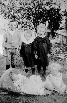 Portrait of five children in a yard, 1900-1910