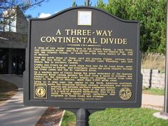 """Three-Way Continental Divide Marker 9 miles south of Eveleth on US 53 at the Anchor Lake Rest Area.  It was erected in 1993 by the Minnesota Historical Society. As the ma rker states, """"A drop of rain water falling here in the Giants Range, a rare three-way continental divide, may flow either north into icy Hudson Bay, east into the Atlantic Ocean, or south into the warm waters of the Gulf of Mexico."""""""