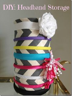 DIY: Easy Headband Storage ~    Supplies:   >Mod Podge   >Fabric   >Empty oatmeal container   >Hot glue  >Spray paint (for the lid).    How To @  http://lifelovelarson.blogspot.com/2013/01/diy-easy-headband-storage.html
