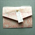 Floral patterned pocketfold wedding invitation finished with an organza bow and tag with crystal. £4.50