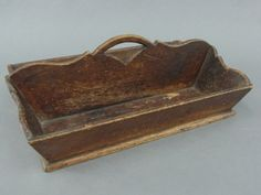 Early Scroll Cut Pine and Ash Cutlery Tray, splayed sided container with ornate cut sides and center divider of ash, a pine bottom, cut nail construction, 6 H. x 15 L. x 11 D.