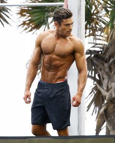 Actor Zac Efron showed off his toned beach bod as he filmed a shirtless scene for the upcoming 'Baywatch' film in Miami, Florida on March 8, 2016.