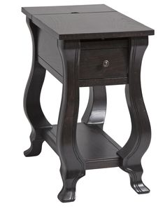 The St. Croix chairside table offers transitional styling allowing it to work within a variety of decors. This table has an ash veneer with an espresso finish making it a very handsome piece. Featurin