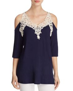 Kim & Cami Lace Cold Shoulder Top | Rayon/spandex; lace: cotton/polyester | Machine wash | Made in USA | Fits true to size, order your normal size | Designed for a relaxed fit | Round neck, cold-shoul