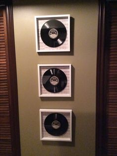 Epson Records I picked up at an antique flea market for $2 each. They are about half an inch thick and can only be played on an Epson Player. I purchased some shadow boxes, layered paper detailed with music notes for the background and hot glued the albums inside. Forever preserved and displayed on the wall, it's a great way to bring the old in with the modern decor.