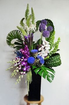 This arrangement too a lot of time!! The weaving of the grasses, etc...but what a gorgeous arrangement!