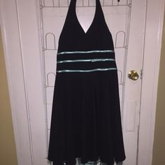 Black Halter Dress w/ Aqua Ribbons Great for prom, weddings, or any other fancy event! A black halter dress with aqua colored ribbons in the middle with a small bow. Underneath the bottom part of the dress is a lacy layer with Aqua color around the bottom edge. If you have any questions please ask! Fashion Bug Dresses Mini