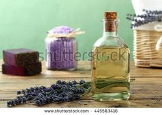 cosmetic products Lavender oil sea salt and soap on rustic background  - stock photo