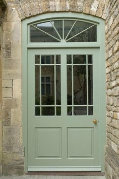 front entry with stone walls and ornate farrow and ball lichen painted front door, hemlock green from pantone color of month may 2014