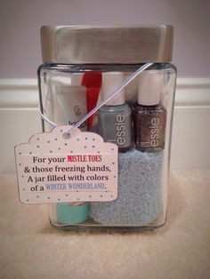 DIY Nail Polish Christmas Gift I made these for my best friends for Christmas! Inside contains: Two Essie nail lacquers (Parka Perfect and Ignite the Night), a nail file, nail polish remover, a pack of regular cotton rounds, Jergens Original Scent lotion, and a pair of fuzzy socks.