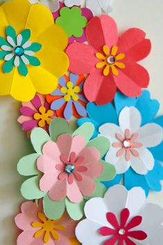 Detail of spring wreath of paper flowers paper flower decor, flower crafts, diy flowers Paper Flowers For Kids, Paper Flower Wreaths, Paper Flowers Craft, Giant Paper Flowers, Paper Roses, Flower Crafts, Diy Flowers, Construction Paper Flowers, Paper Daisy