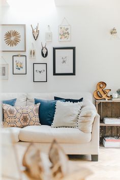 Cream Sofa With Eclectic Gallery Wall And Wooden Crates - A Modern Country Farrow & Ball Kitchen With Oak Parquet Flooring
