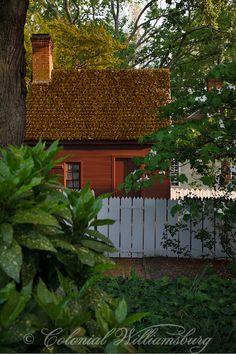 Campbell's Tavern Garden  between the tavern and Isham Goddin Shop. Spring at Colonial Williamsburg. Photo by David M. Doody