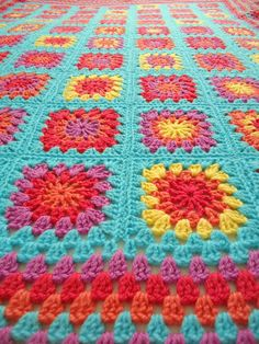This is a vibrant granny square afghan measuring 100cm in width by 145cm in length. The afghan consists of 70 squares and a large border. The turquoise and orange coloured yarn is 75% acrylic and 25% wool and the other yarn colours are 1005 acrylic.    Wash as wool.