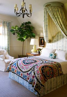 What a great plant! I'm also loving that Suzani duvet and canopy...mmm.