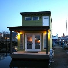 "A ""Sweet Pea"" of a houseboat designed and built by Affordable Floating Homes."