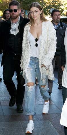Gigi Hadid Artfully Pairs White Sneakers with a Woven Rope Jacket and Pearl-Covered Jeans from InStyle.com