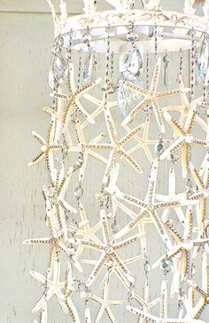 Starfish Chandelier DIY Chandelier. Such a beautiful easy DIY project. you can also use any treasures that you found on your last mermaid adventure! #finfun #mermaids #mermaidtail