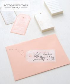 Start with a tag shaped stamp for addressing your wedding invitation envelopes.
