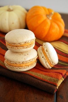 True French macaroons are going to be my next baking conquest! I'll probably pop a little Champagne while I make 'em!  ;)  Pumpkin Spice French Macarons via FoodieMisadventures.com