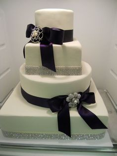Wedding Cake with purple ribbons. #weddingcake