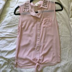 Baby Pink sheer sleeveless Tank Top Worn once. Sheer so you would have to wear a tank top or bralette underneath. Has cute studded detail as pictured and has a tie in the front. Size small Monteau Tops Tank Tops
