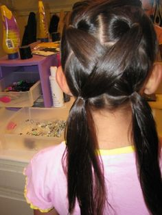 this is my favorite to do for my duaghter- I do 3 pigtails on each side- add LOTS of spray gel.. stays all day- she woke up with them still in this AM!