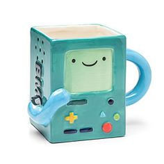 It's Adventure Time! This great molded ceramic mug is in the shape of Beemo! Holds 24 ounces of your favorite beverage. The perfect gift for any Adventure Time fan! Cute Coffee Mugs, Cool Mugs, Coffee Cups, Funny Coffee, Coffee Coffee, Stars Disney, Deco Table, Mug Cup, Clay Art