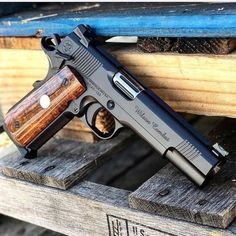 Wilson Combat anniversary CQB Elite - I'd actually carry this piece pull those pretty grip panels replace them with s flat bottom mag well, Ambi cut, thumb notch, in OD. Really like the fluted hood and Barrel. Weapons Guns, Guns And Ammo, 1911 Pistol, Revolver, Colt 1911, Kimber 1911, Wilson Combat 1911, Bushcraft, Fire Powers