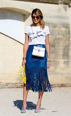 Fringe is a hot trend - Blogger Helena Bordon outside the spring 2015 shows in Paris. Photo: Imaxtree