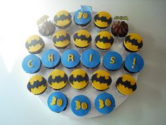 Batman Cupcakes :) He's 30 and has these. I'm going to be 21 and have these same cupcakes. Then a year later I will use this idea for Paxton's 1st birthday. AHHA such a child.